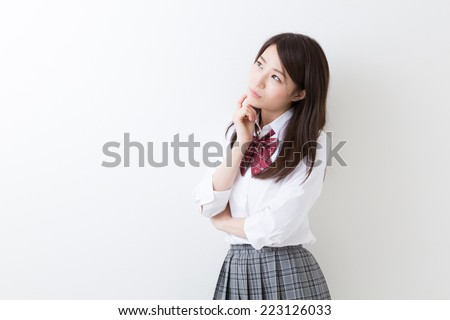 Beautiful young asian school girl - stock photo