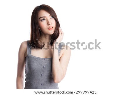 Beautiful young asian woman thinking and looking to copyspace, isolated on white background - stock photo