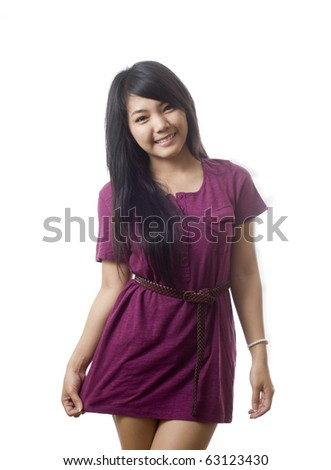 Beautiful young Asian woman wearing a dress - stock photo