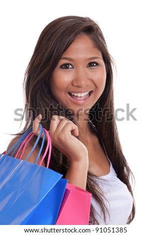 Beautiful young Asian woman with shopping bags isolated on white - stock photo