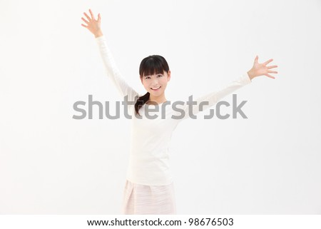 Beautiful young Asian women raise their hands in white background - stock photo