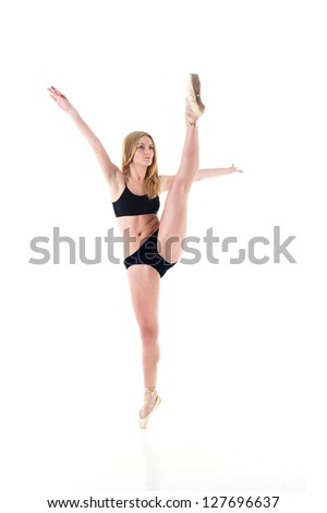 Beautiful young belly dancer, modern ballet.The beautiful ballerina dances on the tips of the toes - stock photo