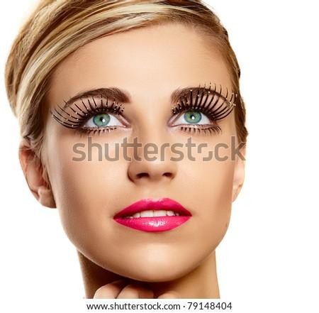 beautiful young blond woman face closeup wearing vogue long lashes and bright pink lipstick - naturally beautiful skin texture - stock photo