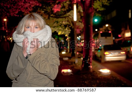 beautiful young blond woman freezes - stock photo