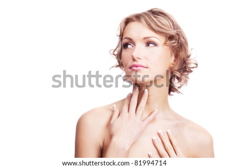 beautiful young blond woman touching her neck, isolated against white background - stock photo
