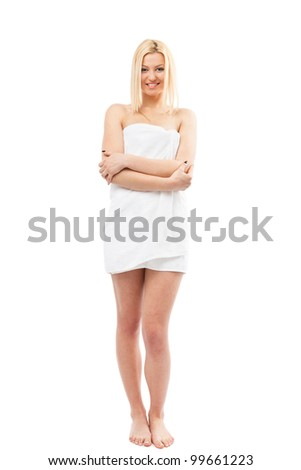 Beautiful young blond woman wrapped in spa towel, isolated on white - stock photo