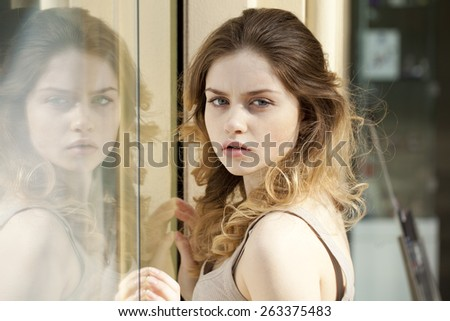 Beautiful young blonde and Mirror reflection - stock photo