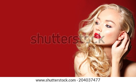 Beautiful young blonde model with red lips - stock photo