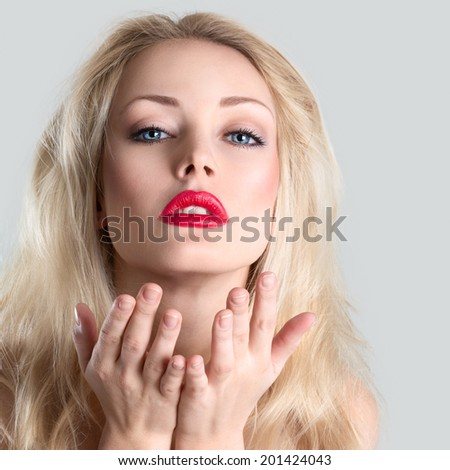 Beautiful young blonde woman blowing a kiss - stock photo