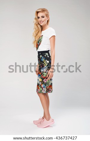 beautiful young blonde woman in nice spring dress, sneakers posing in a studio. Fashion spring summer photo - stock photo