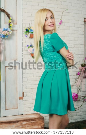 https://thumb101.shutterstock.com/display_pic_with_logo/716773/377159113/stock-photo-beautiful-young-blonde-woman-in-the-short-mint-dress-377159113.jpg