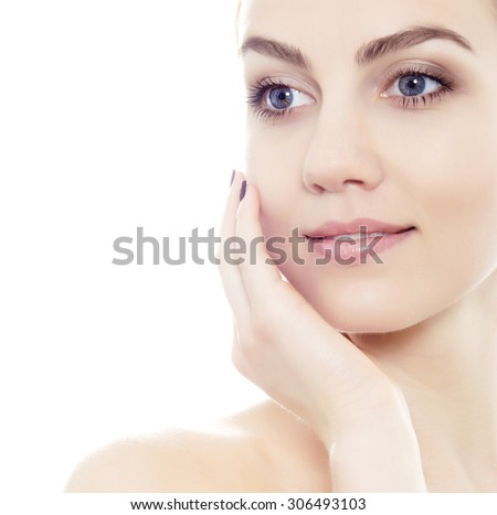 beautiful young blue eyed woman with flawless skin isolated on white - stock photo