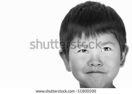 Beautiful young boy with cute smile isolated on white (black and white) - stock photo
