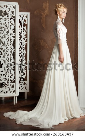 beautiful young bride in elegant classic dress - stock photo
