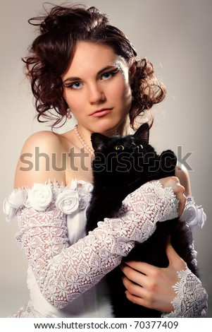 beautiful young bride with black cat - stock photo