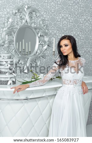 Beautiful young bride with long hair in an interior fashion - stock photo