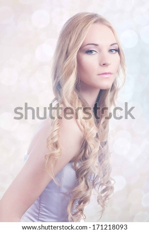 Beautiful young bride with pink make-up and ringlet wedding hairstyle - stock photo