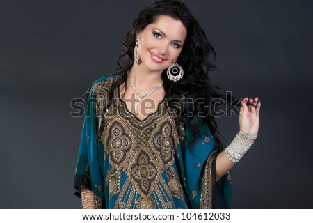Beautiful young brunette belly dance woman - stock photo