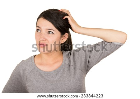 Beautiful young brunette girl posing unsure thinking remembering isolated on white - stock photo