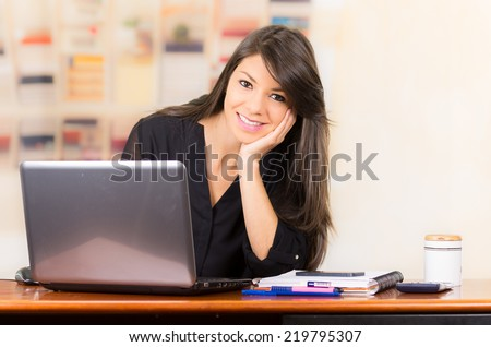 Beautiful young brunette girl student businesswoman professional working with laptop - stock photo