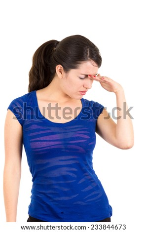 beautiful young brunette latin girl posing sad with hand on forehead isolated on white - stock photo