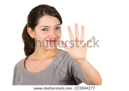Beautiful young brunette sweet girl posing waving hand gesturing five isolated on white - stock photo