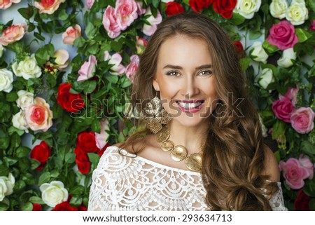 Beautiful young brunette woman in classy white dress on flower wall background - stock photo