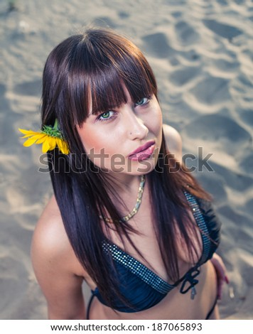Beautiful young brunette woman in summer nature lifestyle portrait. Skincare and beauty face. Sensual girl with long healthy hair outdoors, series. - stock photo