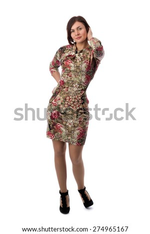 Beautiful young brunette woman with short hair in a dress with a floral pattern. Studio, isolate on white background. - stock photo