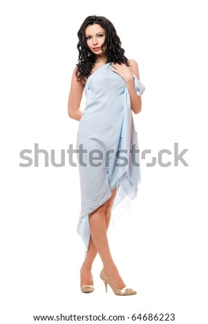 Beautiful young brunette wrapped in blue cloth. Isolated - stock photo