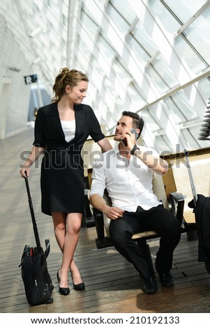 beautiful young business people man and woman waiting in a public transportation station - stock photo