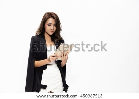 Beautiful young business woman holding and working with a tablet, isolated white background. - stock photo