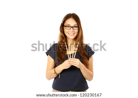 beautiful young business woman holding pencils isolated on white - stock photo