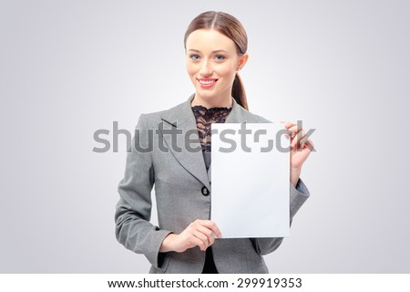 Beautiful young business woman in formal wear holding blank card. Isolated on white background smiling female portrait. - stock photo