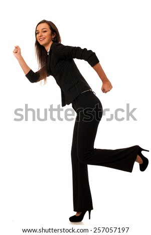 Beautiful young business woman running isolated over white - stock photo