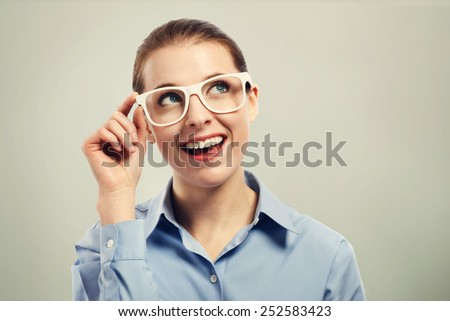 Beautiful young business woman wearing big white eye glasses - stock photo
