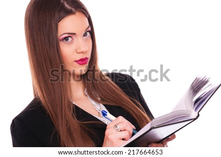 Beautiful young business woman writing in notepad, isolated on white - stock photo