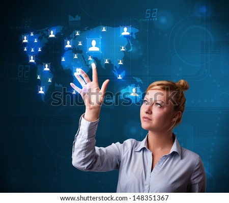 Beautiful young businesswoman choosing from social network map - stock photo