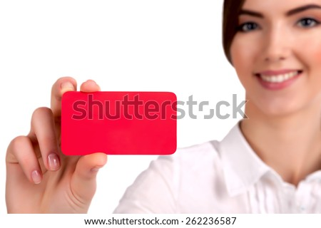 Beautiful Young Businesswoman holding business card - stock photo