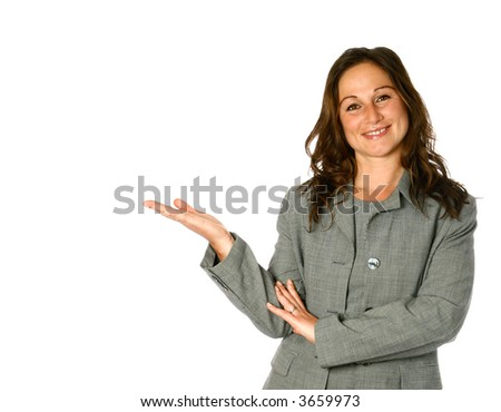 Beautiful young businesswoman in presenting gesture, one hand out with palm facing upwards, isolated on white. - stock photo