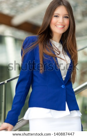 Beautiful young businesswoman portrait in an urban setting - stock photo