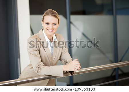beautiful young businesswoman portrait outside office - stock photo