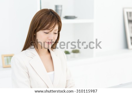 Beautiful young businesswoman working in office - stock photo