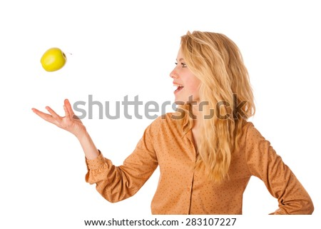 Beautiful young caucasian blonde woman eats a green apple as a sign for healthy eating isolated over white - stock photo