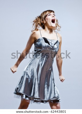 beautiful young caucasian woman girl evening dress screaming angry on studio isolated plain background - stock photo