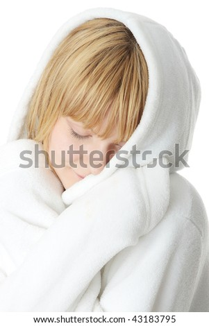 Beautiful young caucasian woman in bathrobe after bath calm portrait. Isolated - stock photo