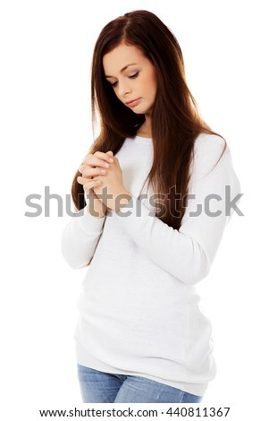 Beautiful young caucasian woman praying - stock photo
