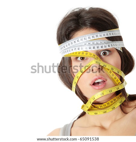 Beautiful young caucasian woman with measuring tape around her head, isolated on white. Diet concept - stock photo