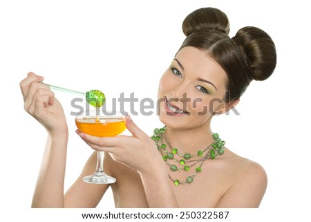 Beautiful young cheerful girl holding honey - stock photo