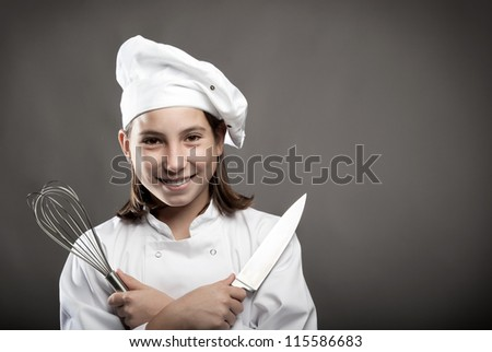 beautiful young chef  on gray background - stock photo
